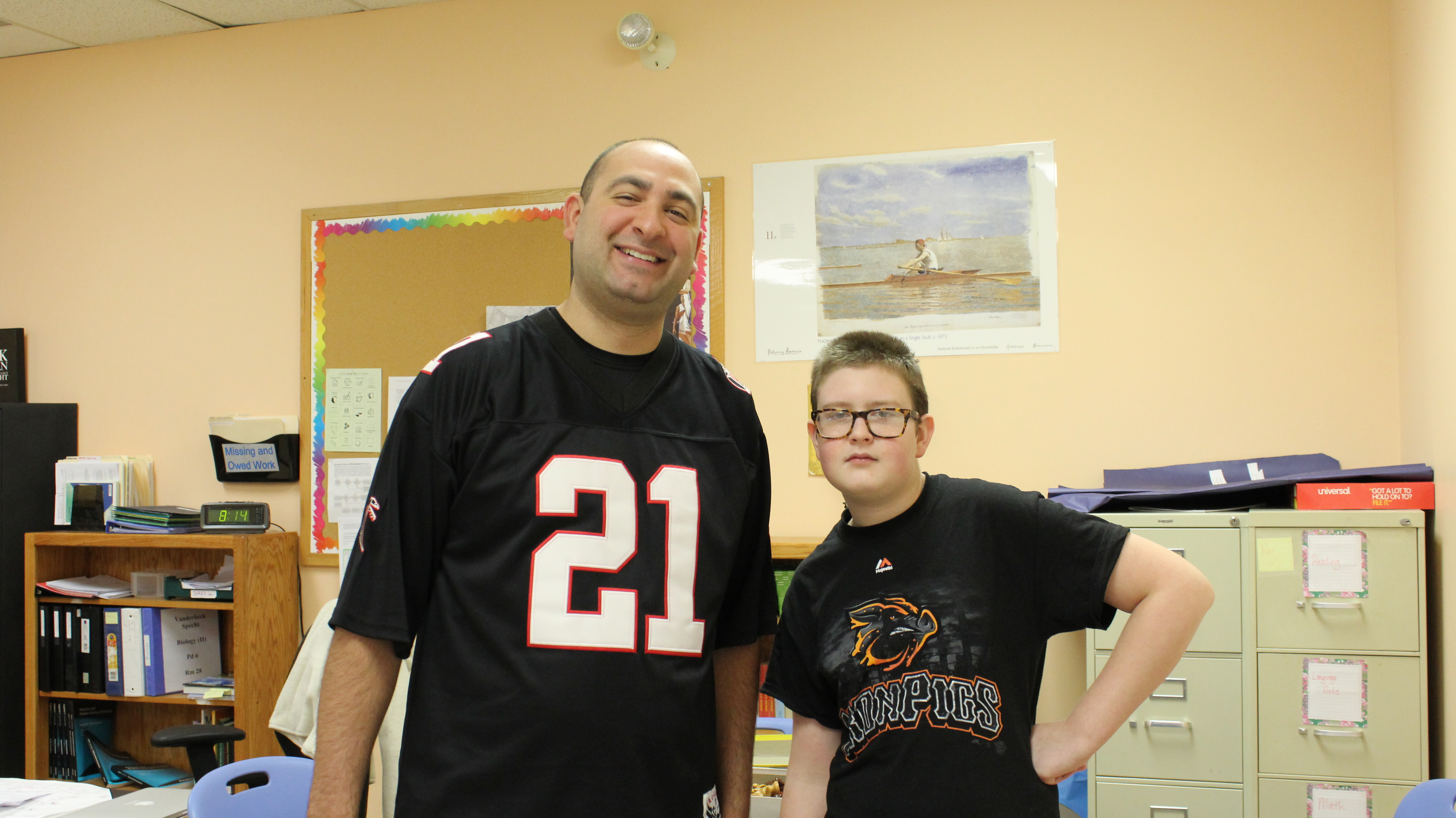 Student and teacher wearing sports jersey