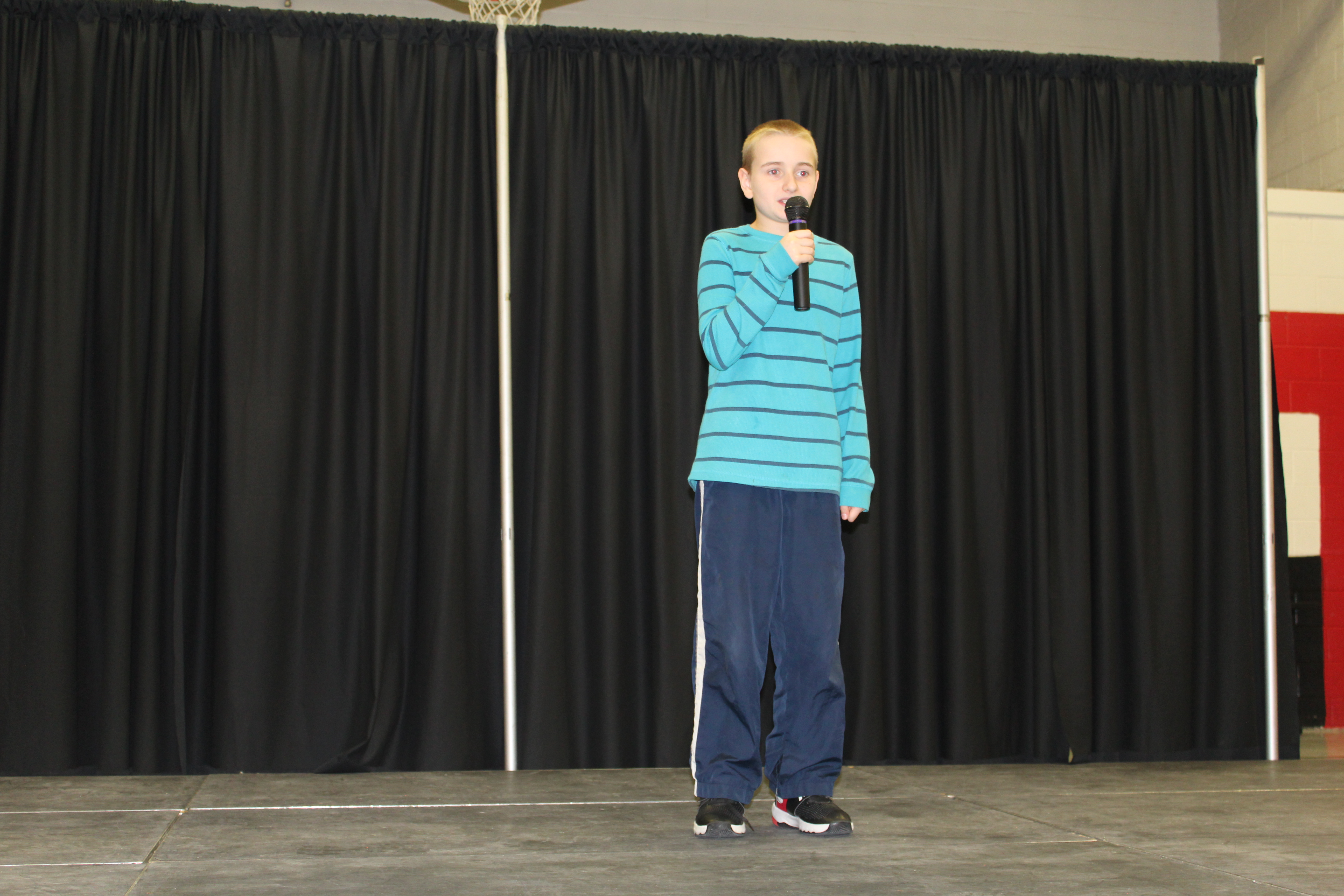 Student standing with microphone
